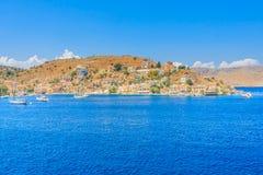 The capital of the island of Symi - Ano Symi. Harani area Stock Images