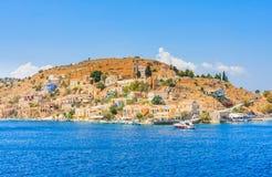 The capital of the island of Symi - Ano Symi. Harani area Royalty Free Stock Photos