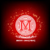 Capital letter M into pattern circle with sparks around on red christmas Stock Photo