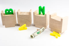 Capital letters of BANK fallen down from building Stock Photos
