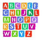 Capital letters of the English alphabet, white chalk, colored chalks. Royalty Free Stock Photo