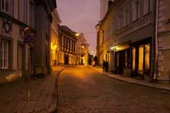 Capital of Lithuania. Night views. Lithuania, Vilnius - September 5, 2017: Capital of Lithuania. Night views of old city and narrow streets of medieval fortress stock images