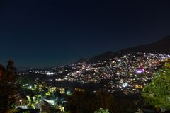 Night view of picturesque kohima in Nagaland. Capital of Nagaland shining at Night under the Stars stock image
