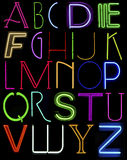 Capital neon letters. Collection of alphabet capital letters against black background Stock Image
