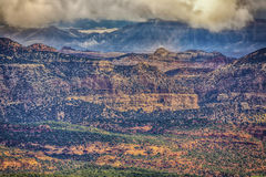 Capital Reef and Henry Mountains HDR. Capital Reef as seen from Highway 12 which  goes over the Boulder mountains wih low clouds and the view of the Henry Royalty Free Stock Photography