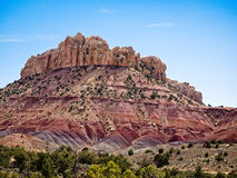 Capital Reef Strata Bluff. The Burr Trail takes the traveler into some of Utah`s most beautiful and extraordinary country.  Drive through Glen Canyon National Royalty Free Stock Photo