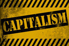 Capitalism sign yellow with stripes Stock Photos
