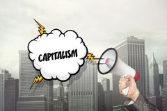 Capitalism text on speech bubble and businessman Stock Image