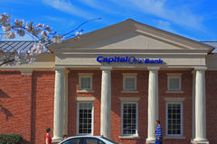 Capital One Bank. Branch store in spring with cherry flower foreground and blue sky, concept for saving, investment, making money. Capital One Financial Royalty Free Stock Photos