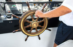 Capitan hand steering a boat Royalty Free Stock Photography