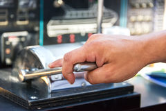 Capitan hand throtling motor boat Stock Image