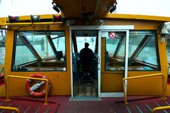 Capitan of river boat at work. In Hamburg, Germany royalty free stock image