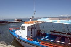 Capitan`s cabine of colourful tour  boats at the pier Stock Photos
