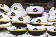 Capitana i cappelli Immagine Stock