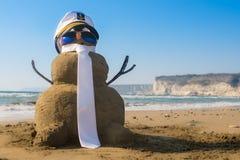 Capitano Snowman fatto della sabbia Immagini Stock