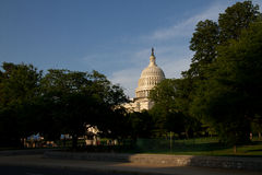 Capitol. In the sunset surrounded by trees Royalty Free Stock Photography