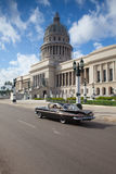 Capitol building and old cars on the road in Havana Royalty Free Stock Image