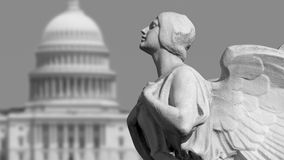 Capitol Democracy. The winged figure of Democracy in front of the United States Capitol in Washington, DC royalty free stock photography