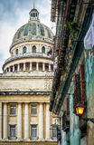 The Capitol of Havana and a shabby building Royalty Free Stock Photography