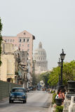 Capitol, havana. Capitol view from Prado street, with an old blue car stock images
