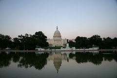 Capitol Hill. At dusk reflecting in pool stock photos