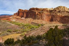 Capitol Reef National Park. Located in south-central Utah, Capitol Reef National Park is a hidden treasure filled with cliffs, canyons, domes and bridges in the stock photos