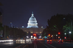 Capitol seen from Pennsylvania Avenue. Night time with traffic rushing by Royalty Free Stock Photos