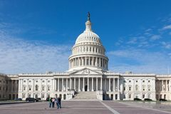 Capitol USA Building at day. People tourists on background of east front at day. White stock photo