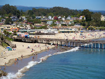 Capitola Beach in California. A view of the beach in Capitola, in summer with few people swimming in the surf, others just enjoying the Sun Royalty Free Stock Image