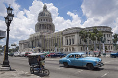 Capitolio, Havana, Cuba. Local rickshaw and vintage car in front of the Capitolio in Havana, Cuba stock photos