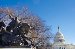 Capitol Dome against a lions`s statue Royalty Free Stock Image