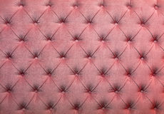 Capitone cor-de-rosa textura adornada de estofamento da tela fotografia de stock royalty free