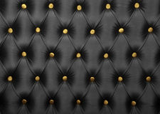 Capitone preto com textura dos botões dourados Imagens de Stock Royalty Free