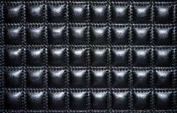 Capitonnage en cuir noir des meubles Photographie stock