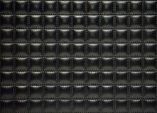 Capitonnage en cuir noir des meubles Photo stock