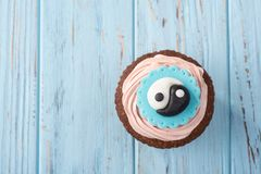Capkake With Eastern Symbols On A Blue Table Stock Image