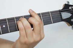 Capo di stato maggiore della difesa della mano della chitarra elettrica Fotografia Stock Libera da Diritti