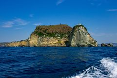 Capo Miseno, Bacoli, view from the boat with waves in the foreground. royalty free stock photography