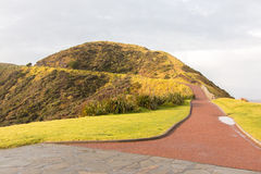 Capo Reinga del faro sull'isola del nord della Nuova Zelanda Immagini Stock
