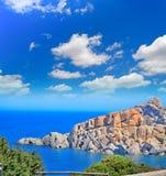 Capo Testa shore under clouds Stock Images