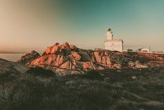 Capo Testa white lighthouse. Sardinia stock photo
