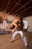 Capoeira后面弯曲 免版税库存照片
