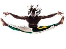 巴西黑人舞蹈家跳舞capoeira剪影 免版税库存图片