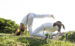 Capoeira couple of awesome stunt outdoors Royalty Free Stock Photo