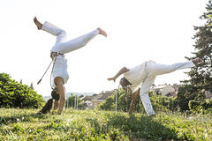 Capoeira couple of awesome stunt outdoors Royalty Free Stock Photos