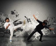 Capoeira fighting. Black and white fighting in the capoeira dance stock photography