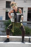 Capoeira girl with accordion Stock Photography