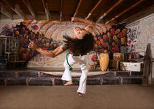Capoeira Performer Leaping Up Stock Image
