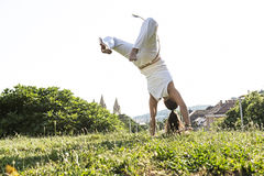 Capoeira woman, awesome stunts in the outdoors Stock Images