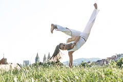 Capoeira woman, awesome stunts in the outdoors Royalty Free Stock Photography